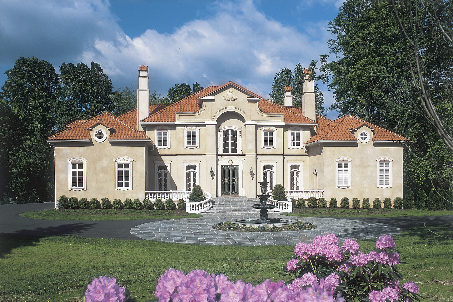 Entrance of mansion in Potomac, Maryland with fountain and circular driveway