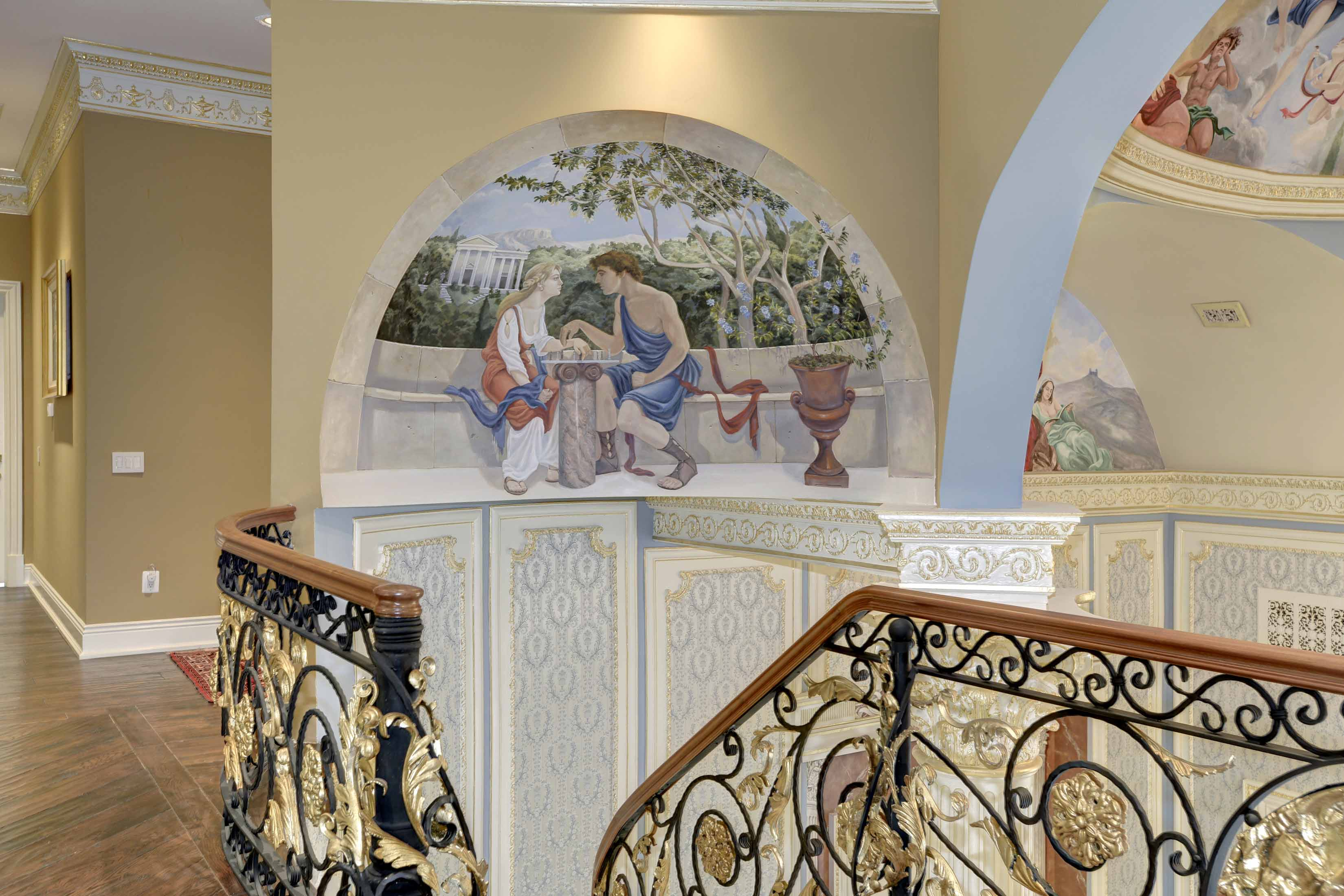 Stairwell with custom murals in dome