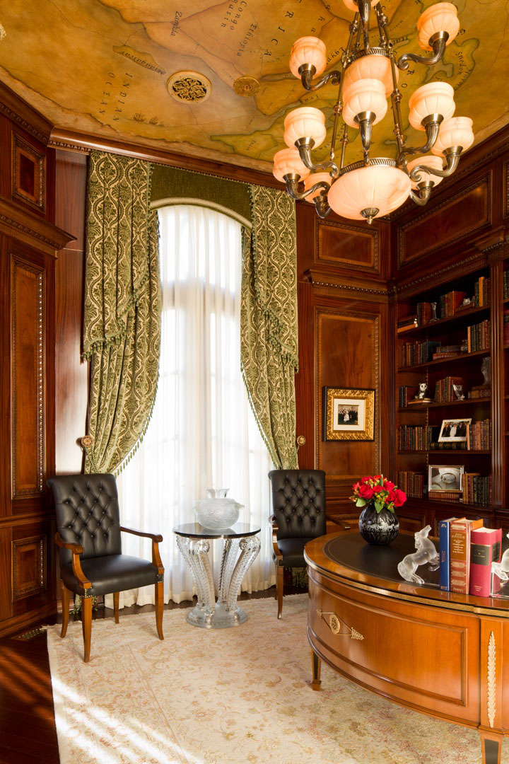 Luxury home office with Lalique table, custom cabinetry and world map ceiling