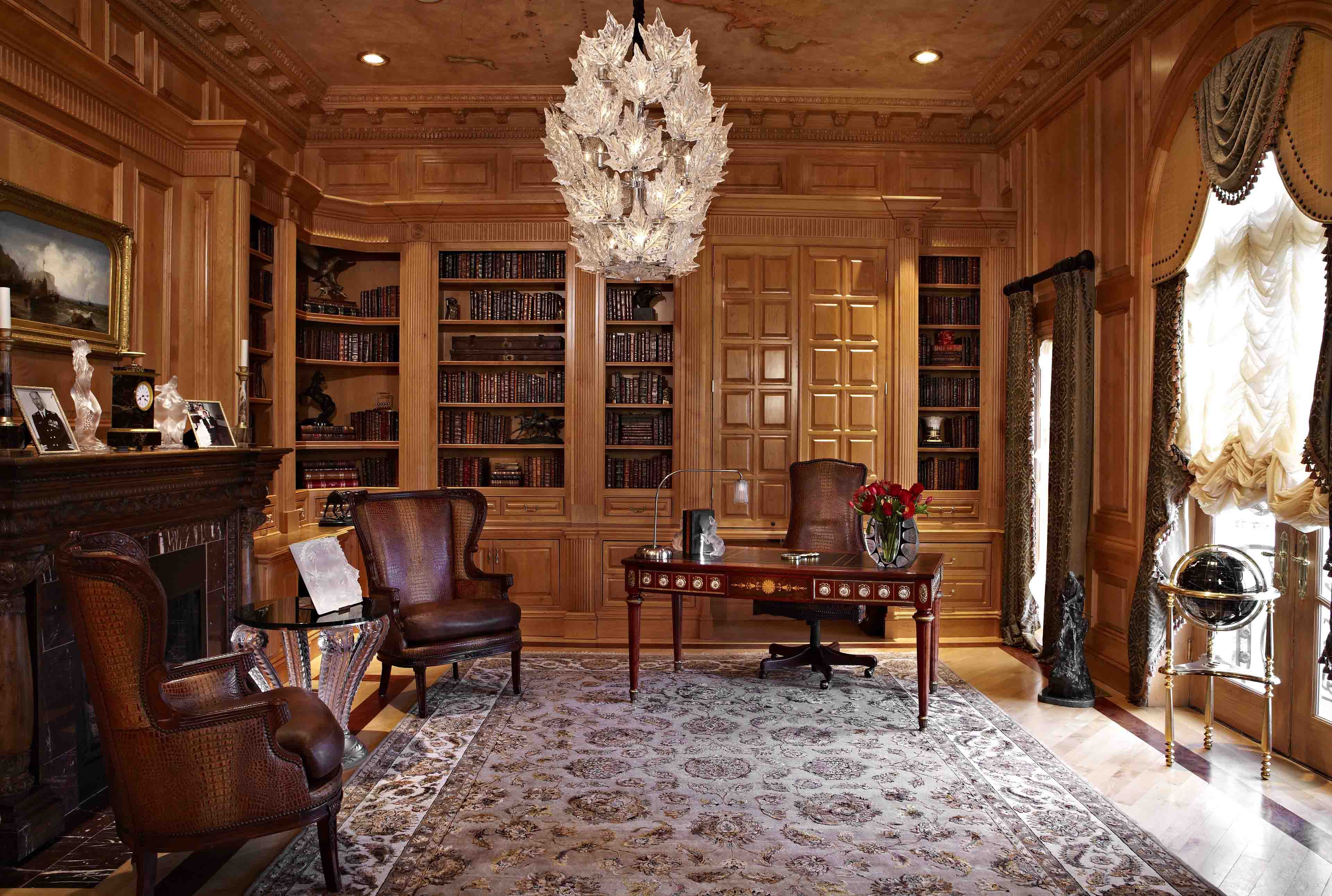 Home office with custom cabinets with fireplace and Lalique chandelier and accents