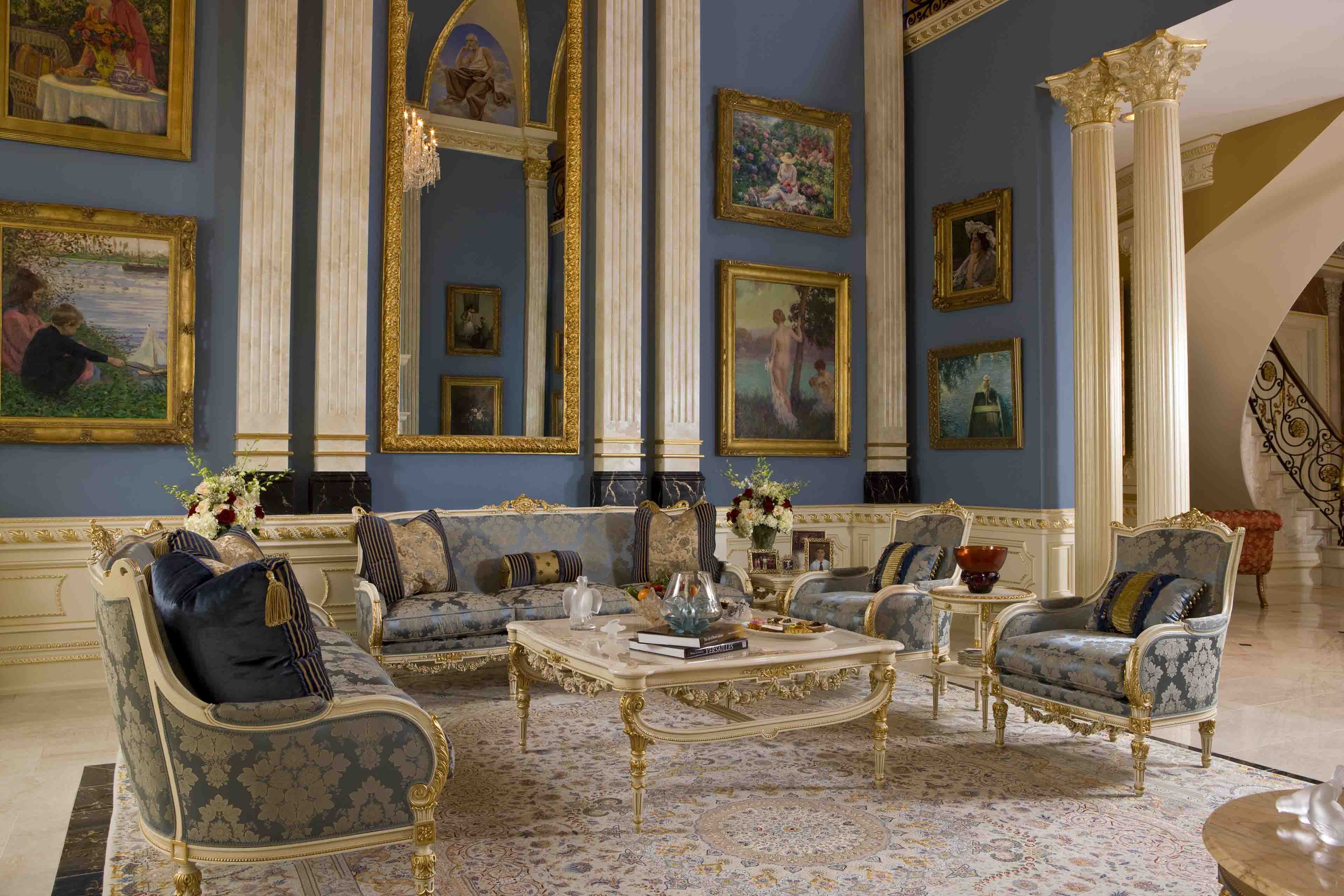 Classical grand salon with blue walls and columns in mansion in Potomac, Maryland