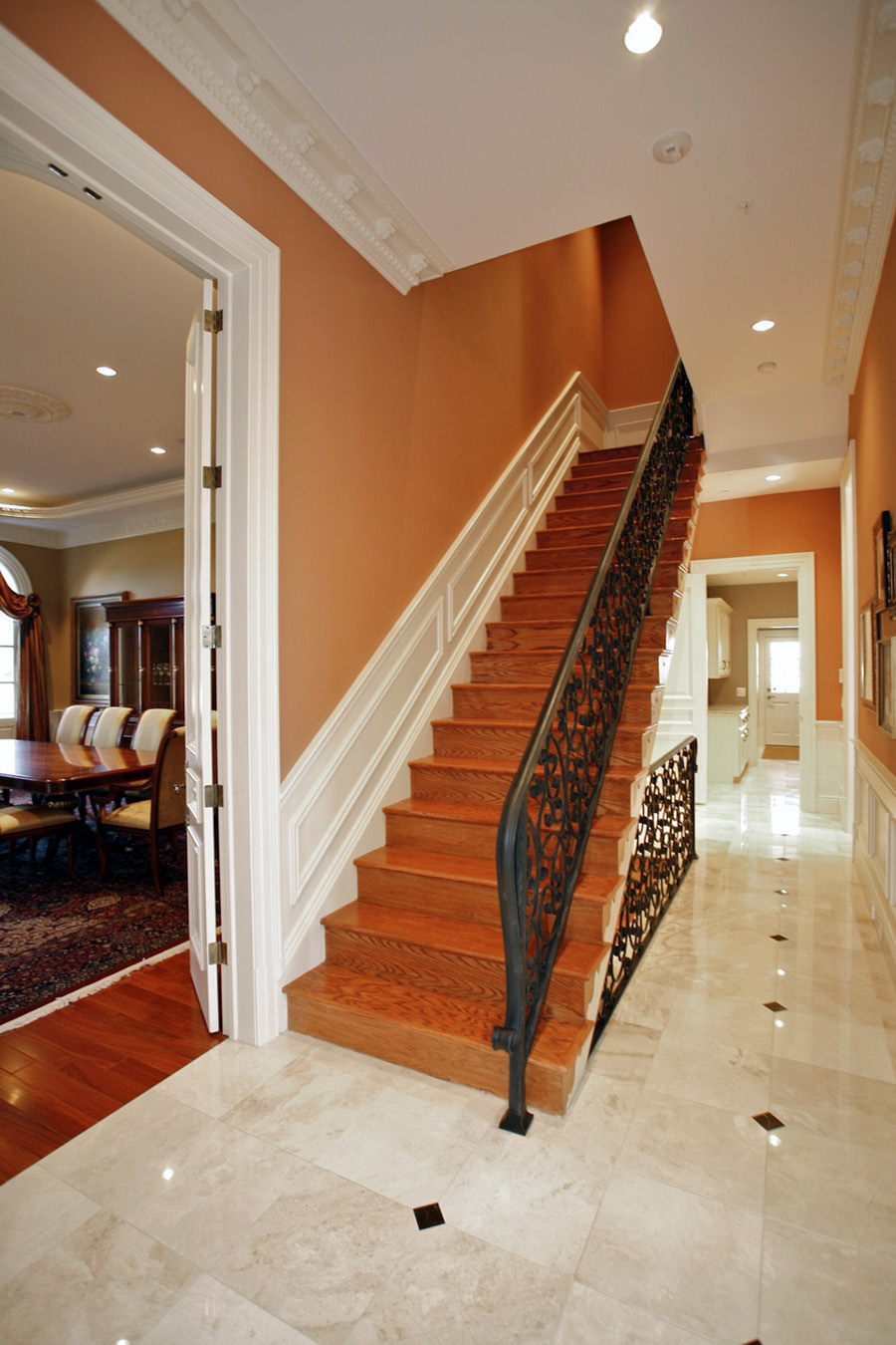 Stairs in mansion in Potomac with orange walls