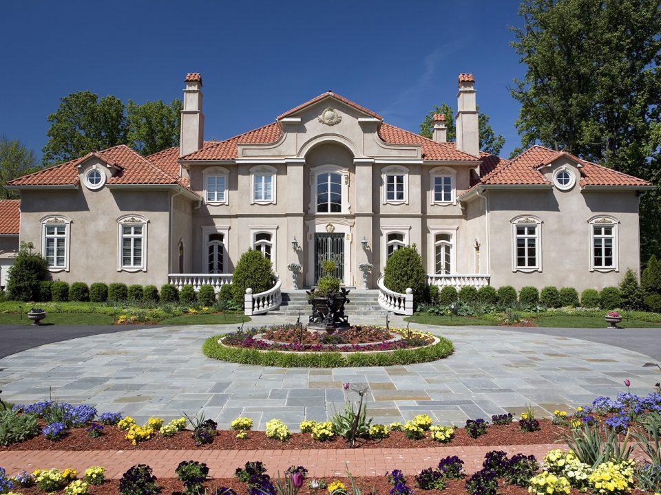 Mediterranean House Entrance with Circular Driveway and garden