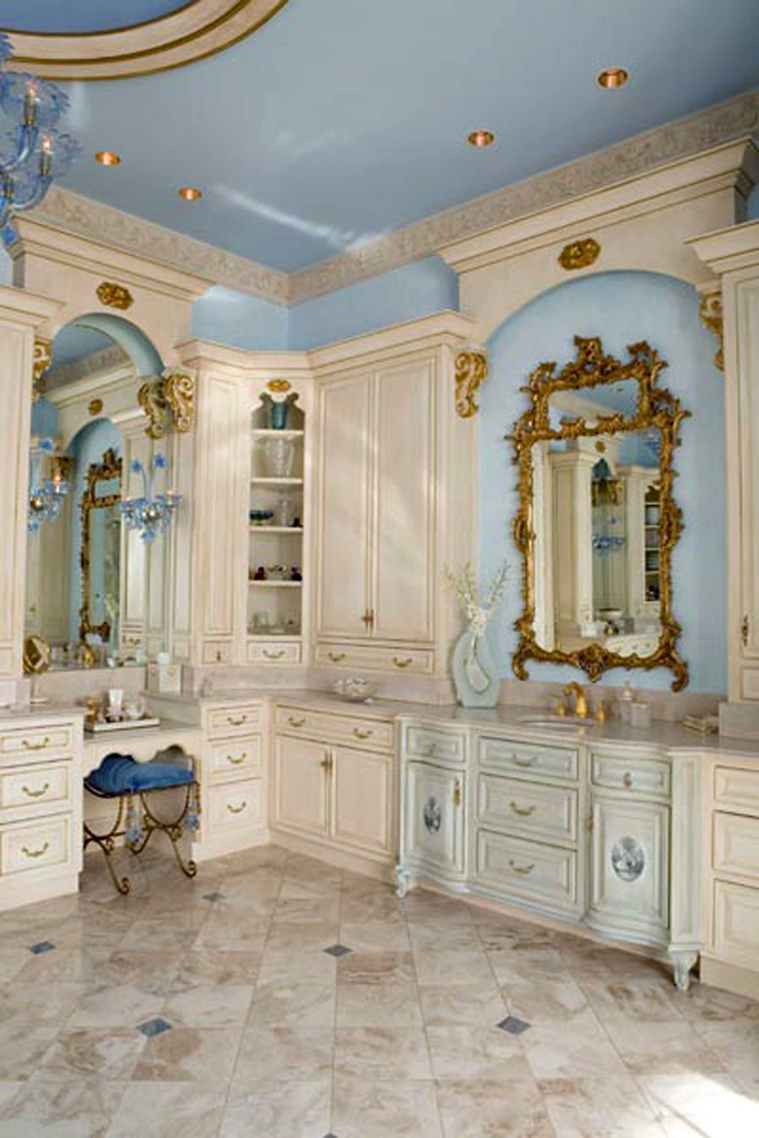 Luxury master bathroom with custom cabinets and blue walls in mansion in Potomac, Maryland