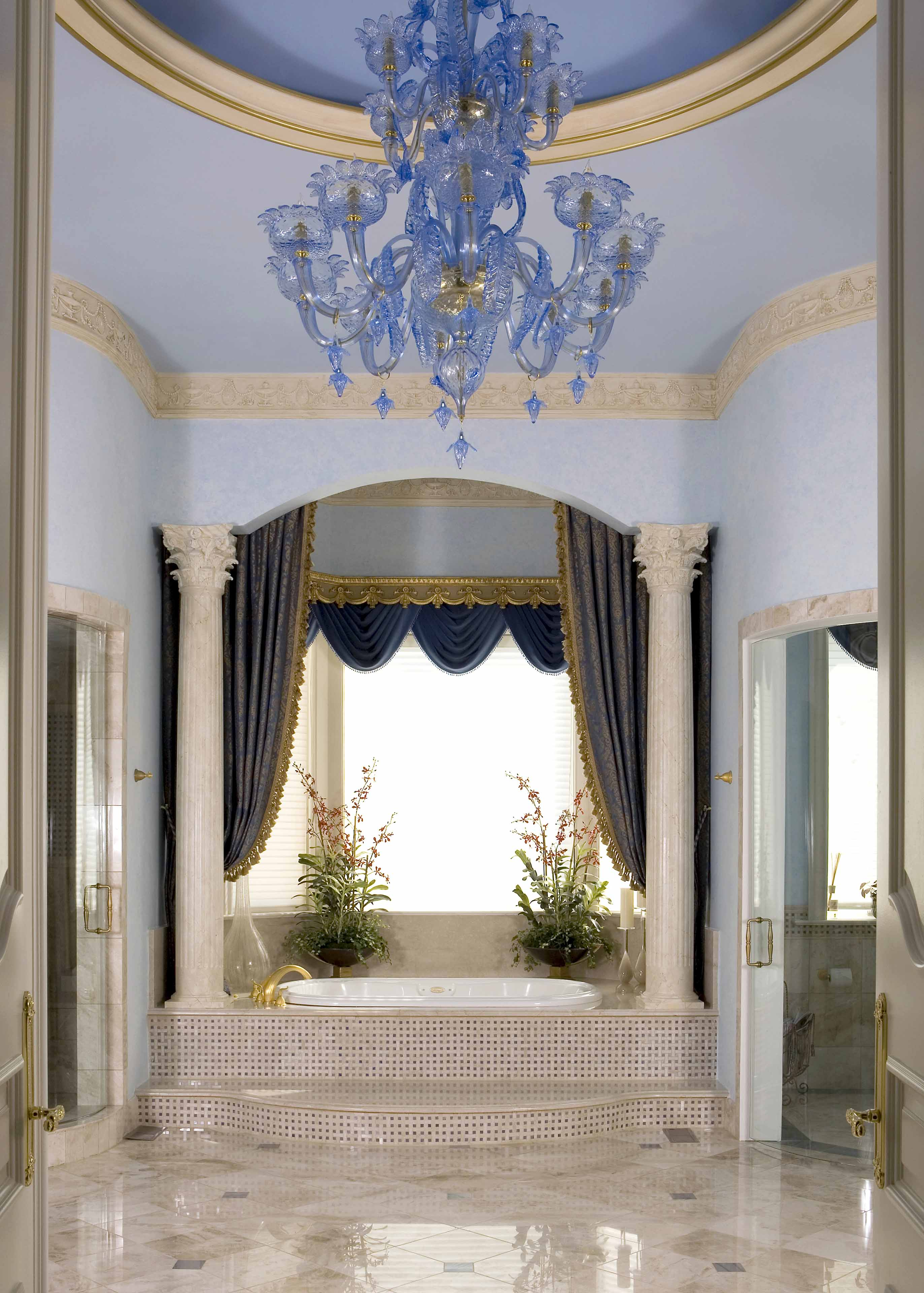 Master bathroom spa with blue ceiling and walls and crystal blue chandelier