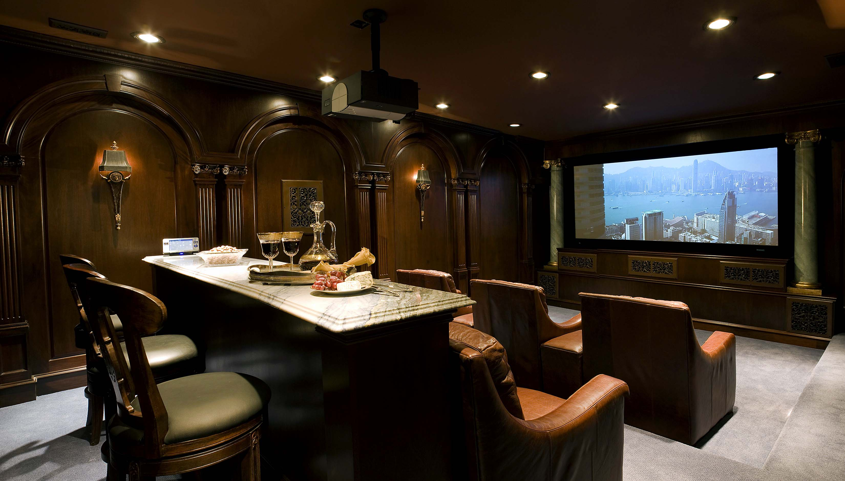 Home theater in mansion in Potomac Maryland with lounge seating