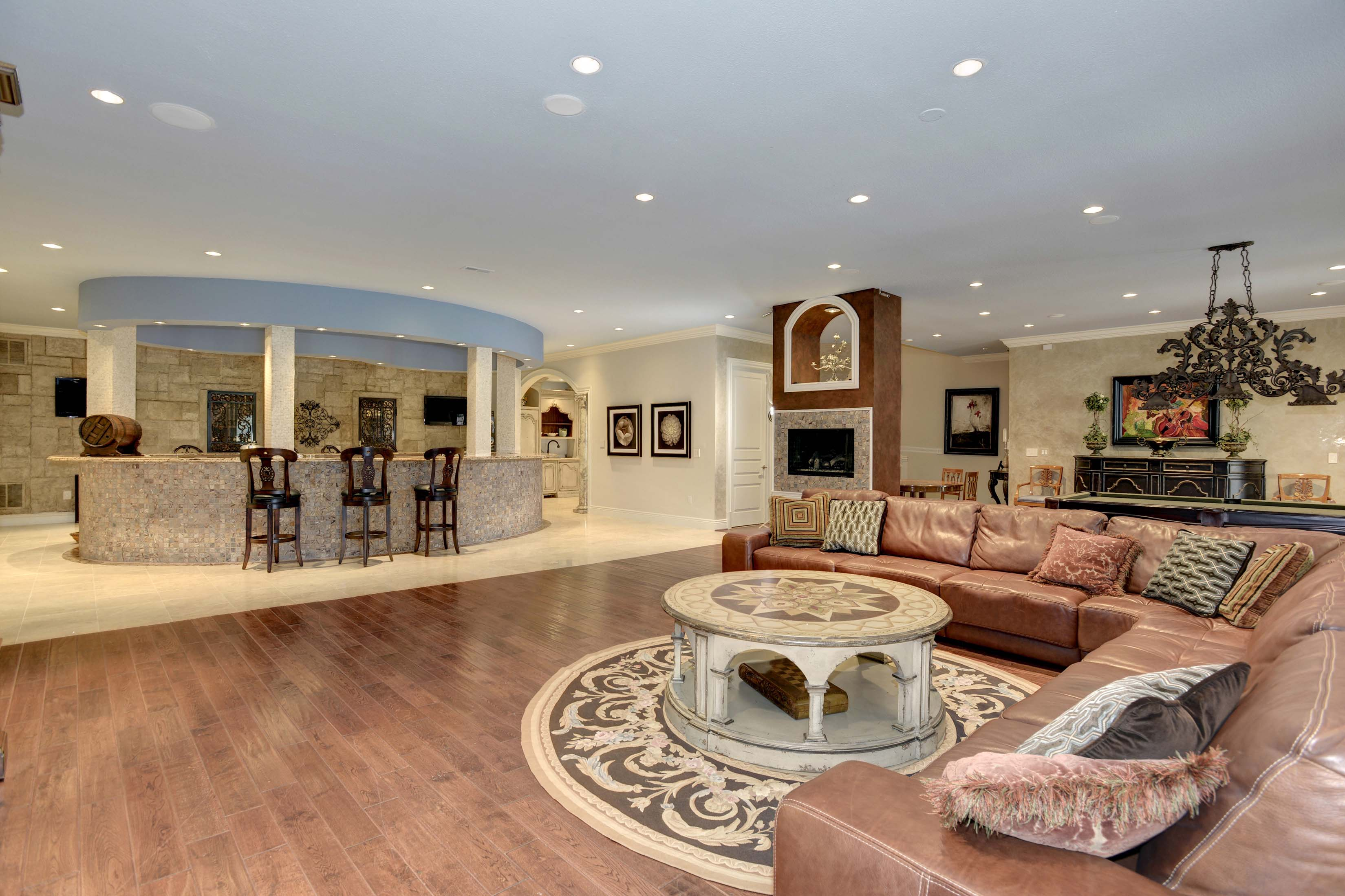 Oval-shaped bar in mansion with seating area in Potomac, Maryland