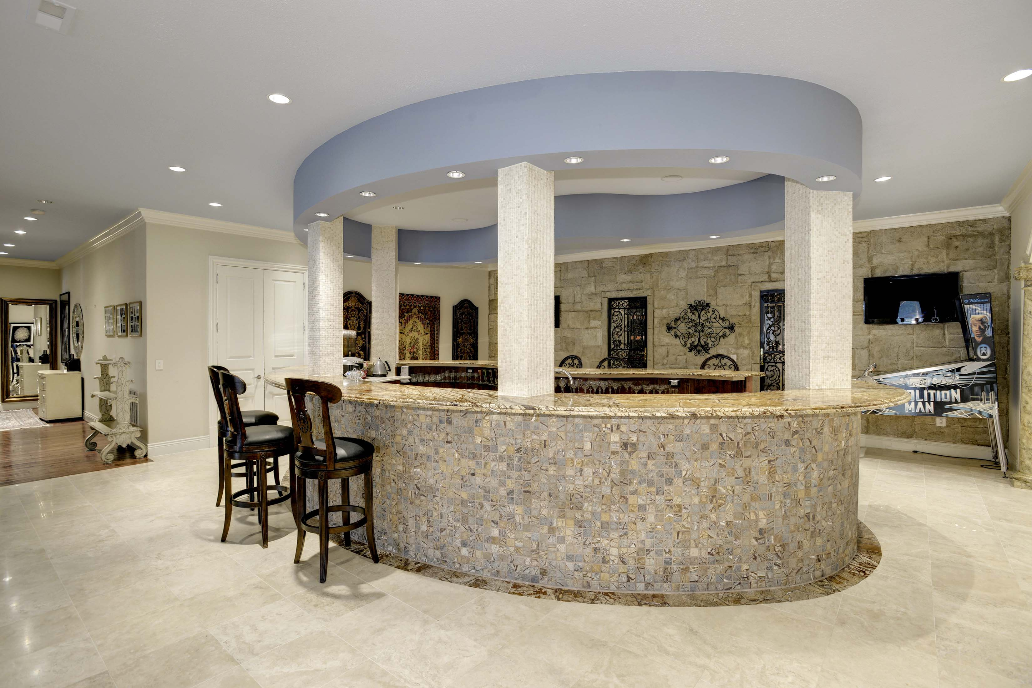Oval shaped bar with wine cellar in mansion in Potomac, Maryland