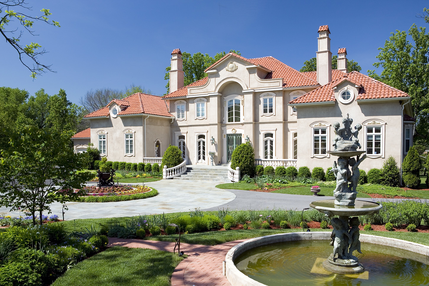 Entrance of a mansion in Potomac, Maryland with fountains and circular driveway