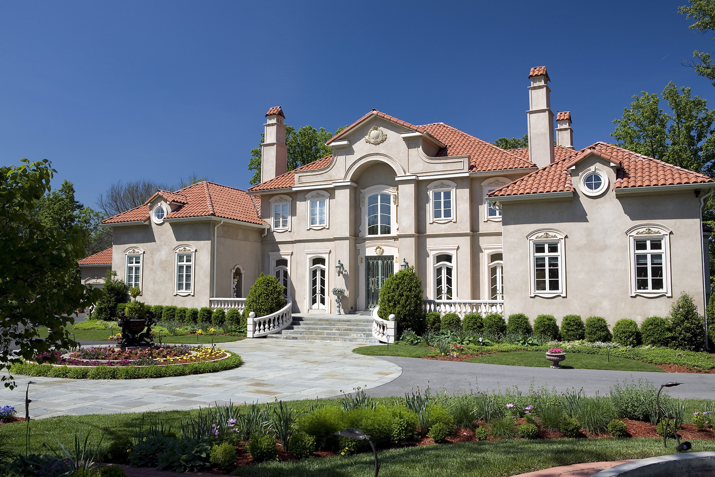 Exterior of mansion with circular driveway with fountain in Potomac, Maryland