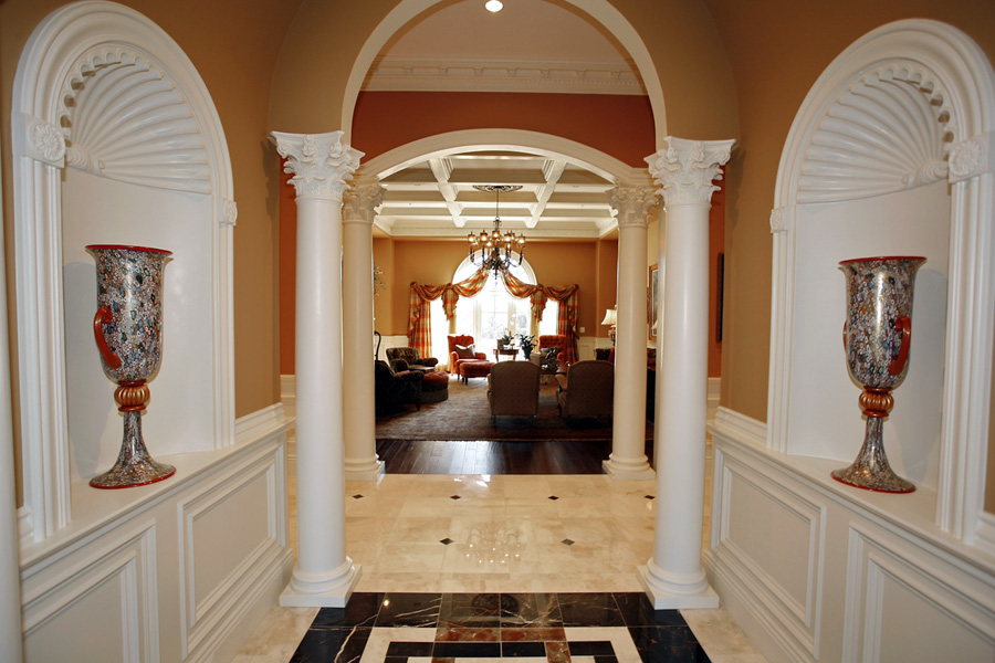 Custom foyer in mansion leading to grand salon in Potomac, Maryland