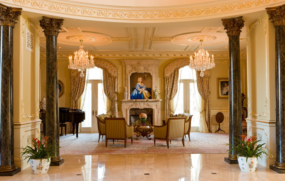 Grand salon with two crystal chandeliers, fireplace and classical furniture