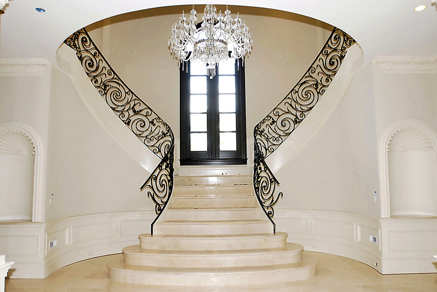 Foyer with curve staircase and crystal chandelier