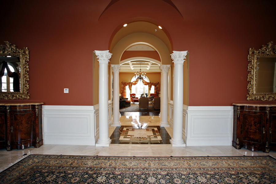 Foyer with columns and persian run in Mansion in Potomac, Maryland