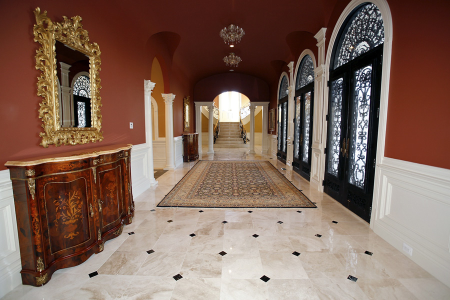 Custom foyer with three front doors and entry table in Mansion in Potomac, Maryland