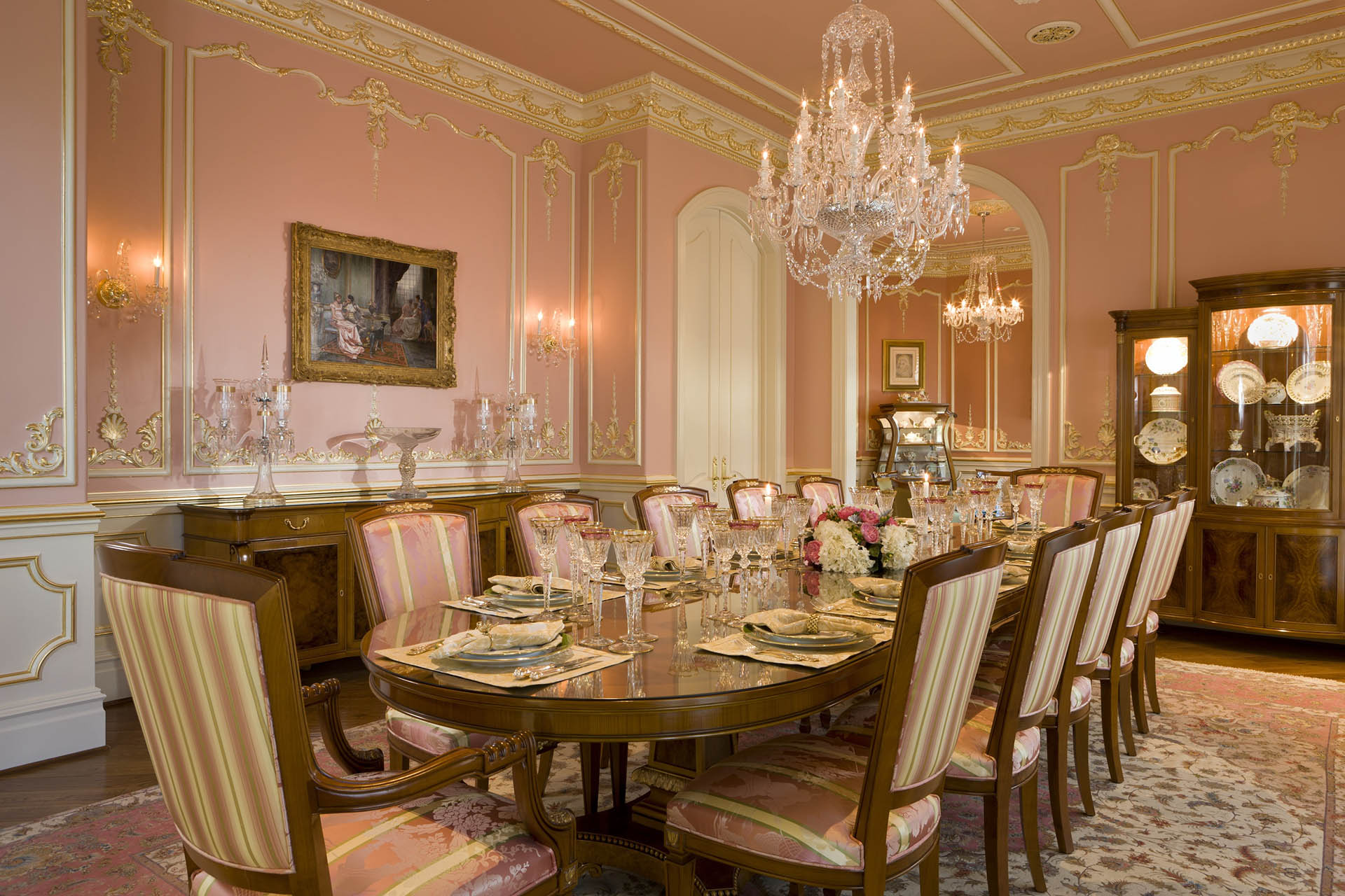 Luxury dining room in Mansion with custom wall panels and crown moldings