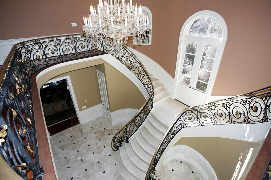 Custom stairs in foyer with elevator in mansion in Potomac, Maryland