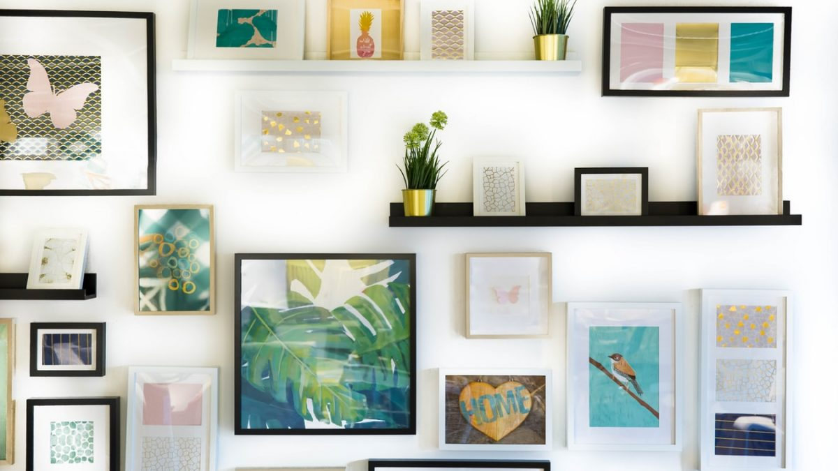 Different color frames on a white wall
