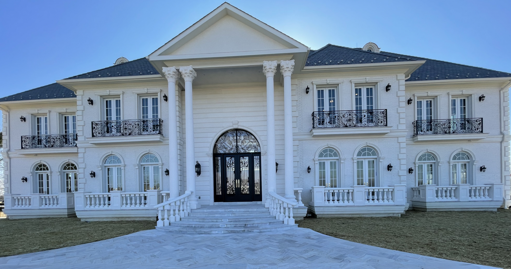Estate Entrance with white pillars